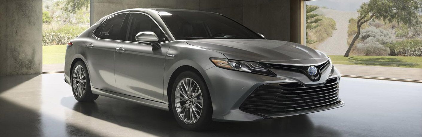 Passenger side exterior view of a gray 2019 Toyota Camry