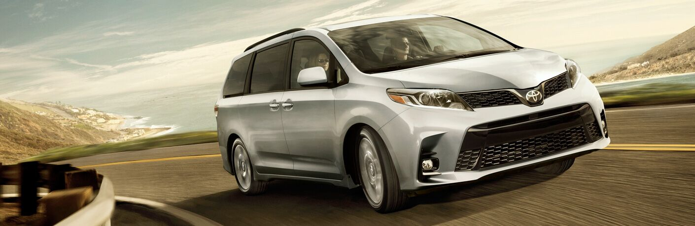 Front passenger side exterior view of a gray 2019 Toyota Sienna