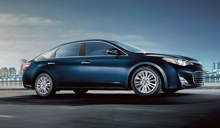 Passenger side view of a blue Toyota Avalon