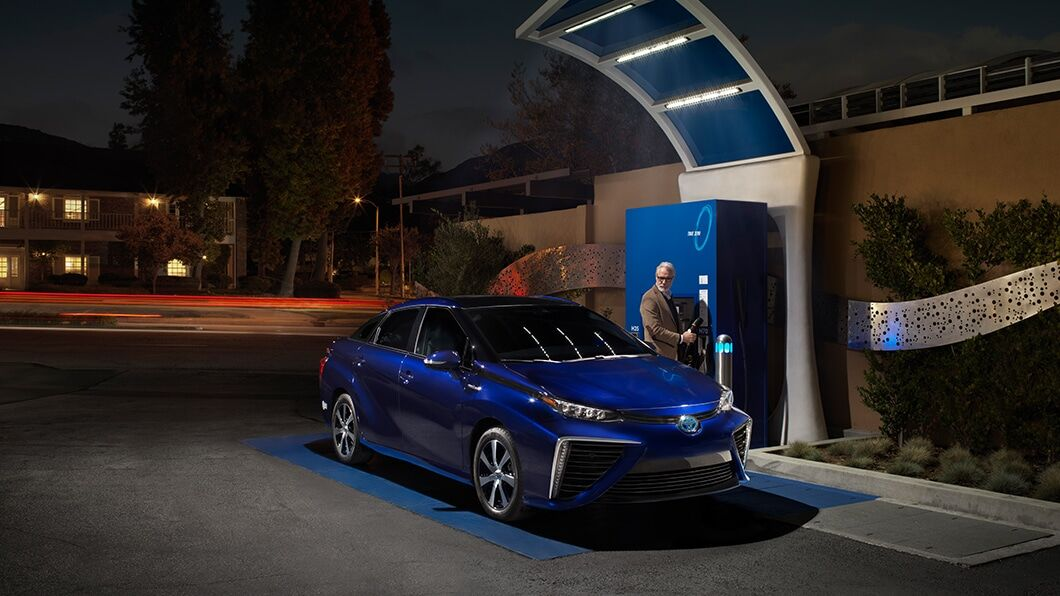 Passenger side exterior view of a blue Toyota Mirai