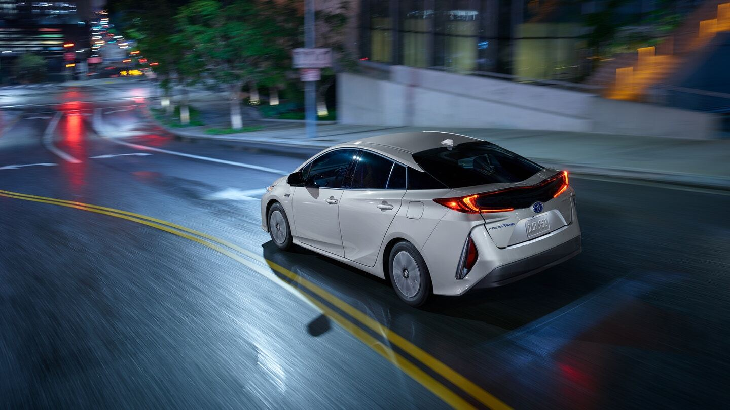 Rear exterior view of a white Toyota Prius Prime