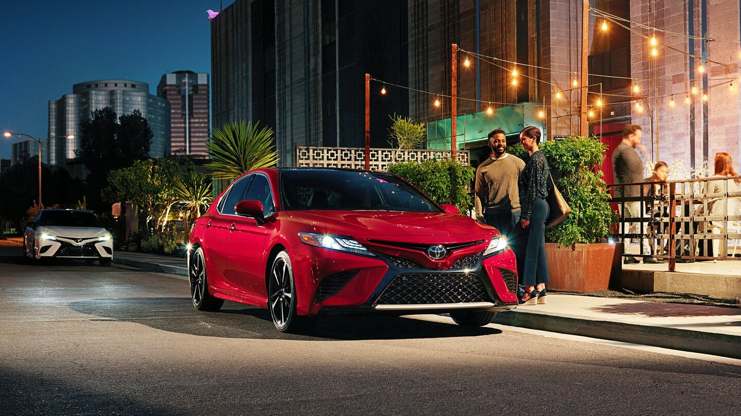 Front exterior view of a red Toyota Camry