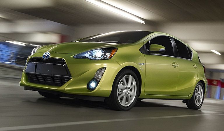 Front exterior view of a green Toyota Prius c
