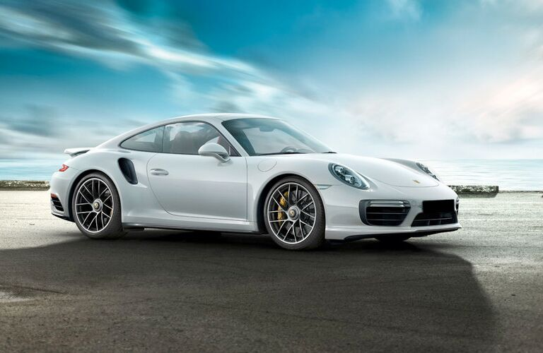 2018 Porsche 911 Turbo S in white with a background of sky