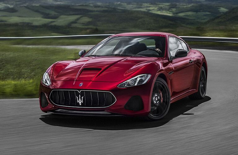 2018 maserati gran turismo driving on track near kansas city