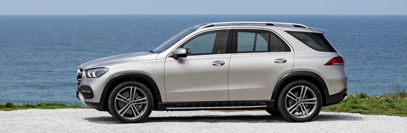 side view of the 2020 Mercedes-Benz GLE in front of water