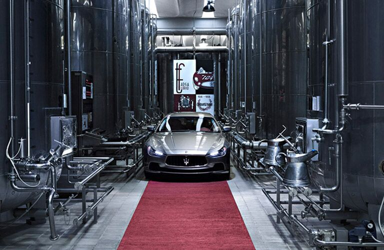 Maserati driving threateningly in a factory