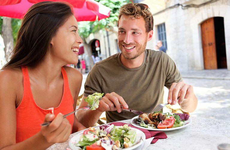 a couple having a nice meal outside