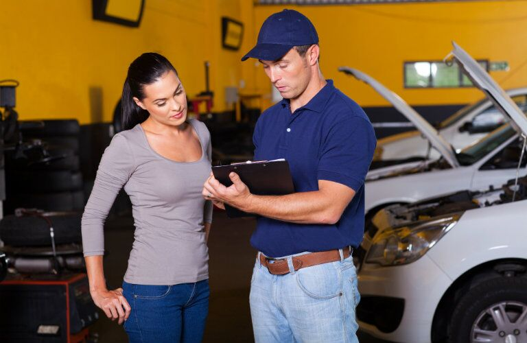 owner reviewing car issues with technician