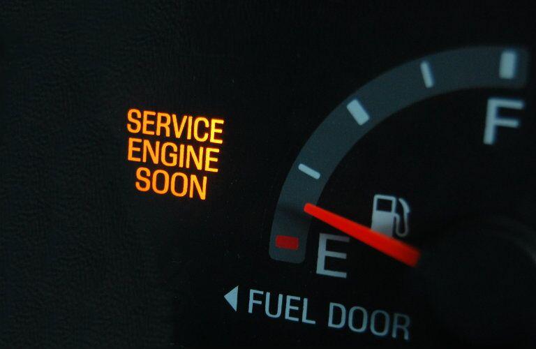 dashboard gauge warning drivers to service engine soon