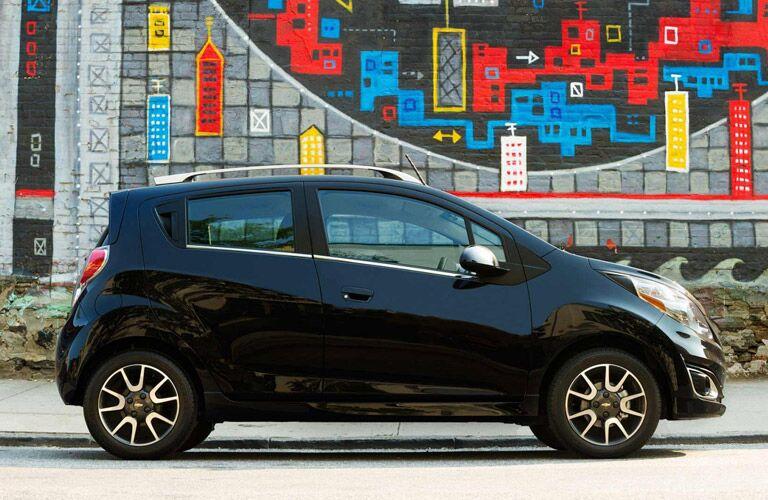 Black Chevy Spark outside art mural