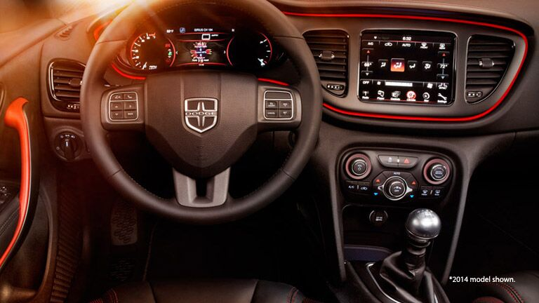 2014 Dodge Dart interior steering wheel shot with orange lens flare