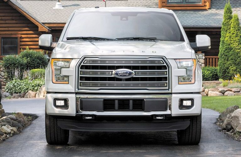 White 2016 Ford F-150 Limited in driveway