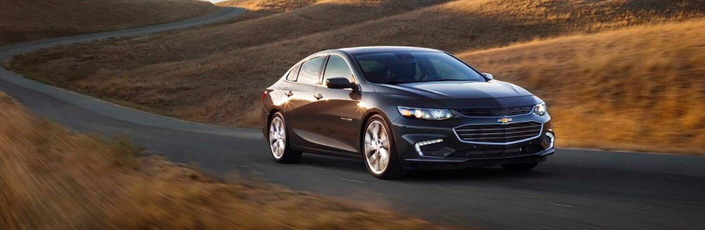 Used Chevrolet Malibu driving down road