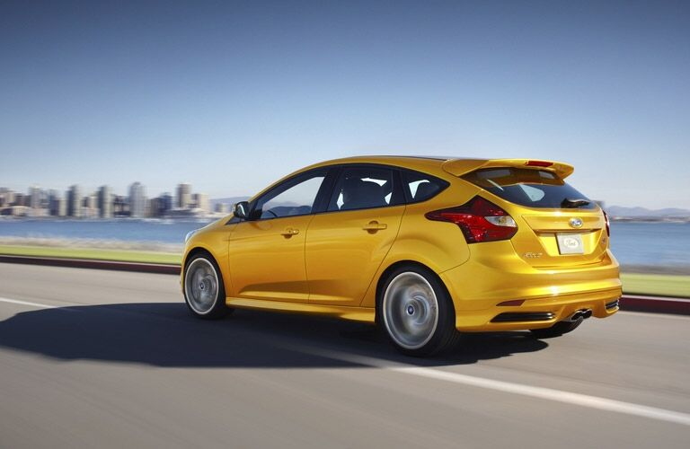 Yellow 2013 Ford Focus driving