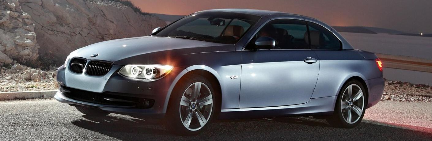 2011 BMW 3 Series 335i exterior front fascia and drivers side on rocky road