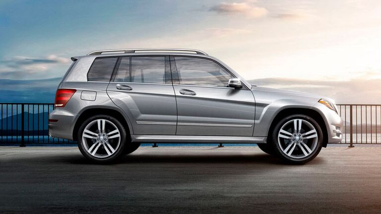 2014 Mercedes-Benz GLK 350 exterior passenger side profile on road with railing and lake and mountains in distance