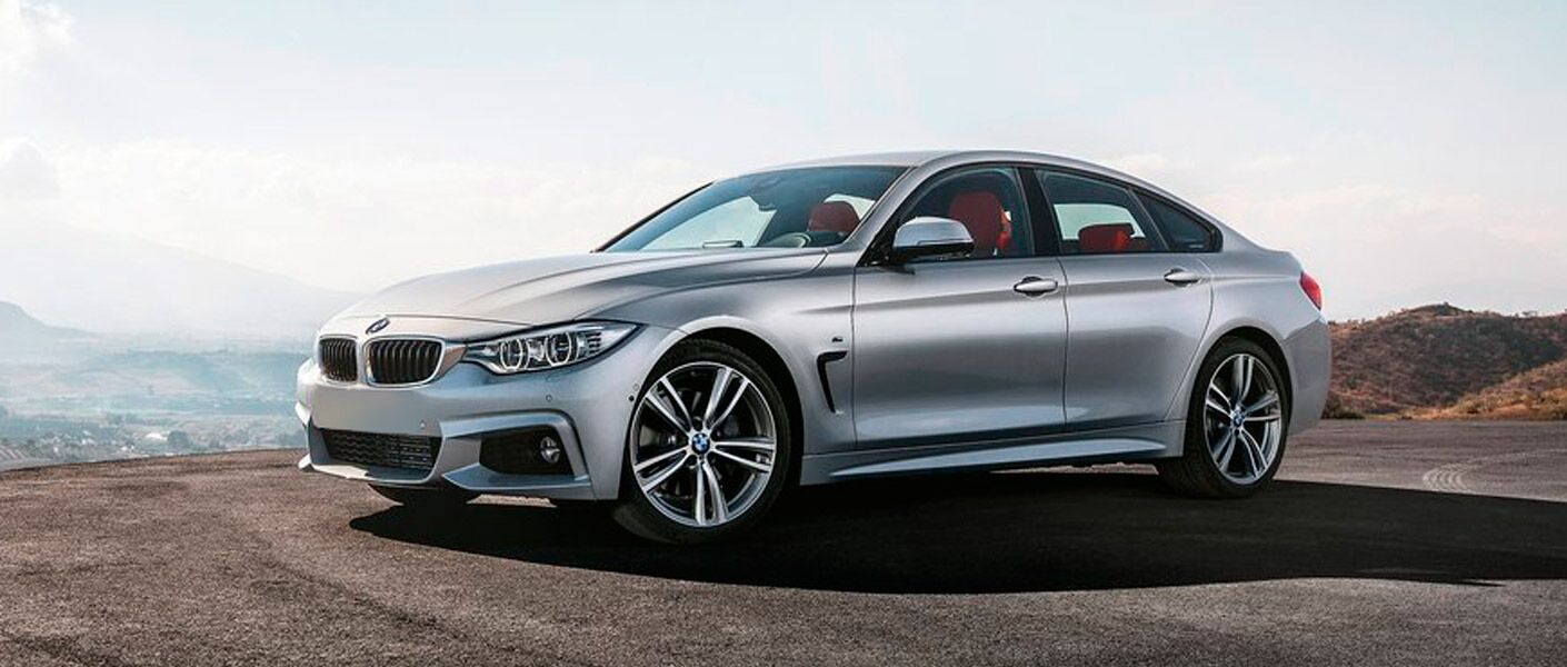 2015 BMW 4 series exterior front fascia and drivers side on cliff