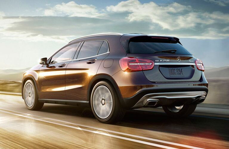 2015 Mercedes-Benz GLA250 exterior back fascia and drivers side on road with sunlight in front