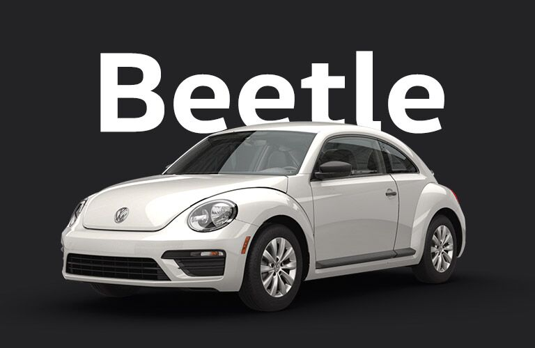 white Volkswagen Beetle with black background