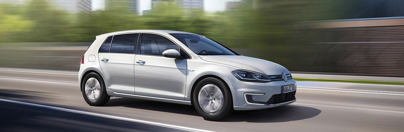 White 2017 Volkswagen e-Golf driving down the highway