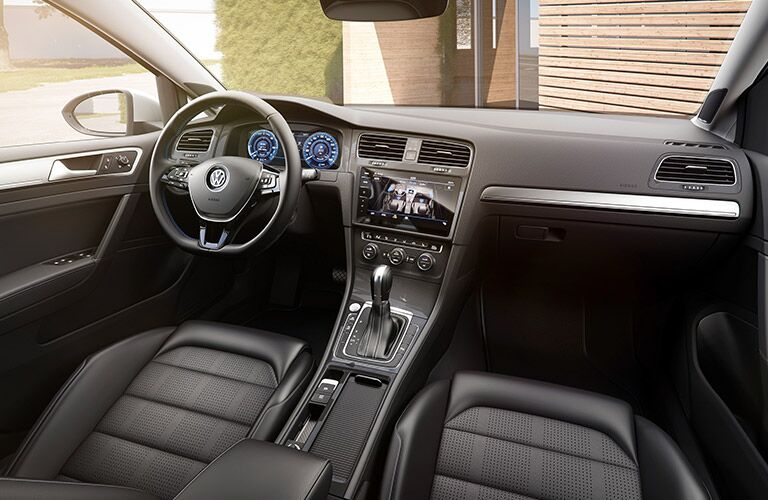 Steering wheel and touch screen inside the 2017 Volkswagen e-golf