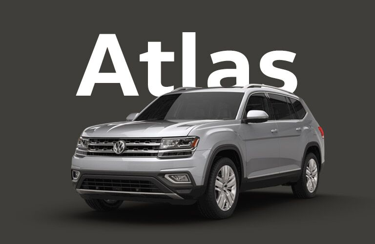 silver Volkswagen Atlas with dark gray background