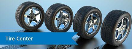 four car tires, tire center link