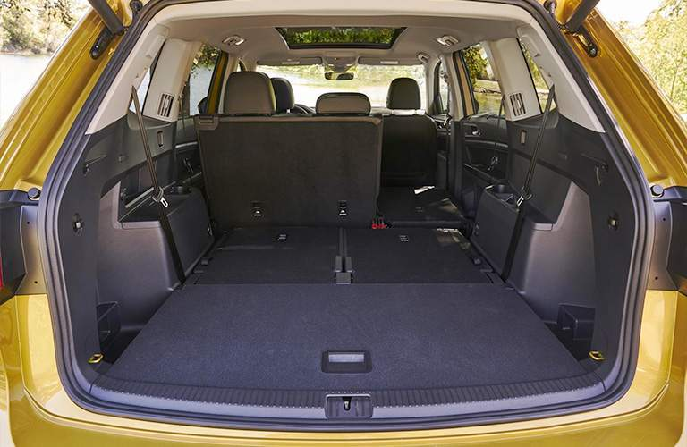 Cargo area of 2018 Volkswagen Atlas with partially collapsed seats