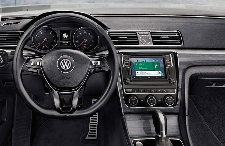 Steering wheel and VW Car-Net App-Connect infotainment system in 2018 Volkswagen Passat