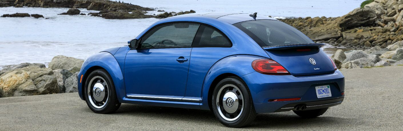Blue 2018 Volkswagen Beetle parked near the ocean coast