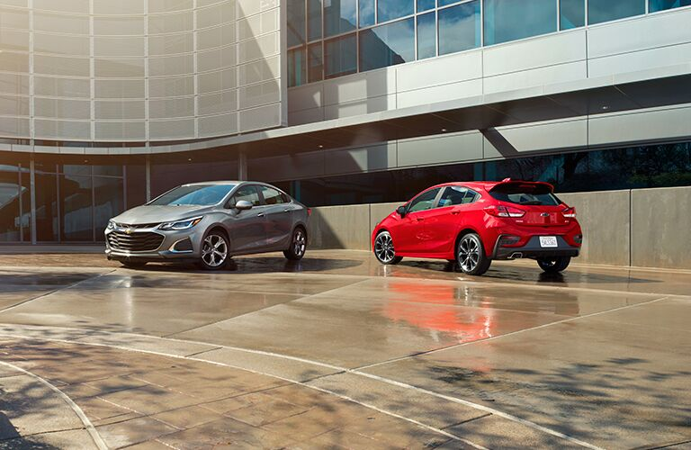 2019 Chevy Cruze silver sedan and red hatchback side by side