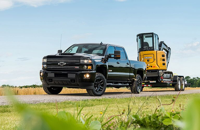 2019 Chevy Silverado 2500HD blacked out towing a trailer
