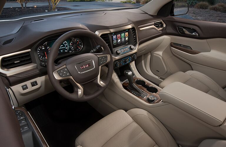 2018 GMC Acadia Denali tan leather interior with steering wheel and dash
