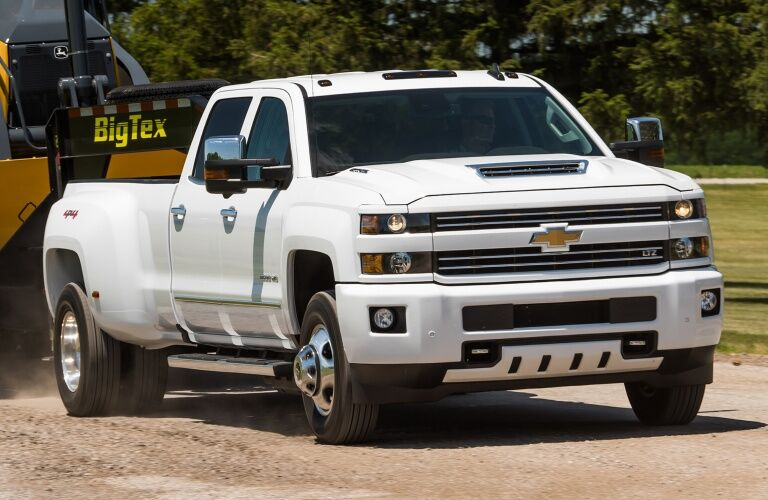 2018 Chevy Silverado 3500HD white front view with trailer