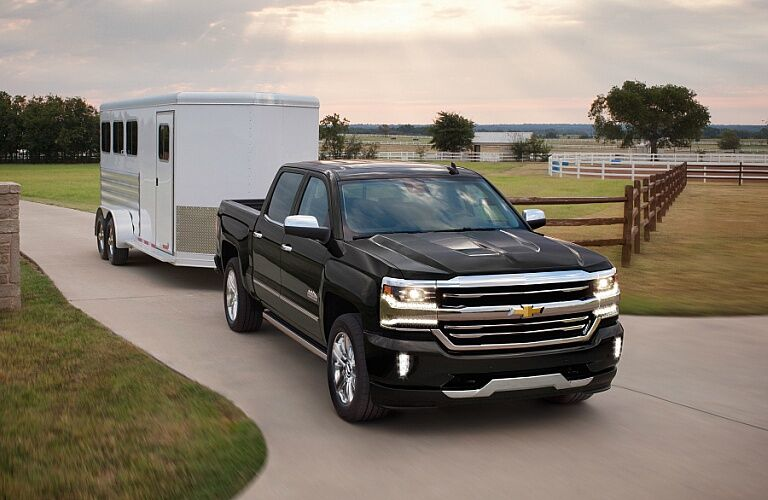 2018 Chevy Silverado 1500 black towing a trailer