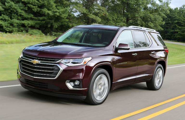 2018 Chevy Traverse maroon side view
