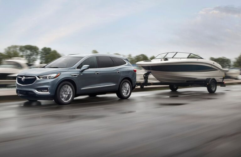 2019 Buick Enclave blue side view towing a boat