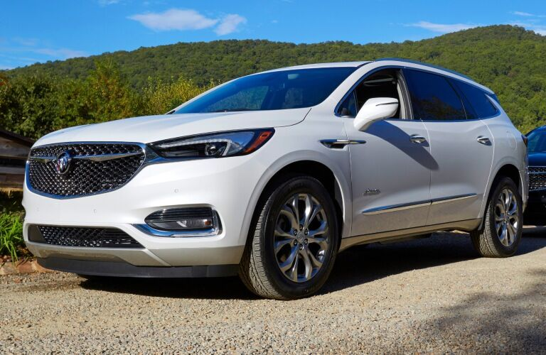 2019 Buick Enclave white side view on gravel