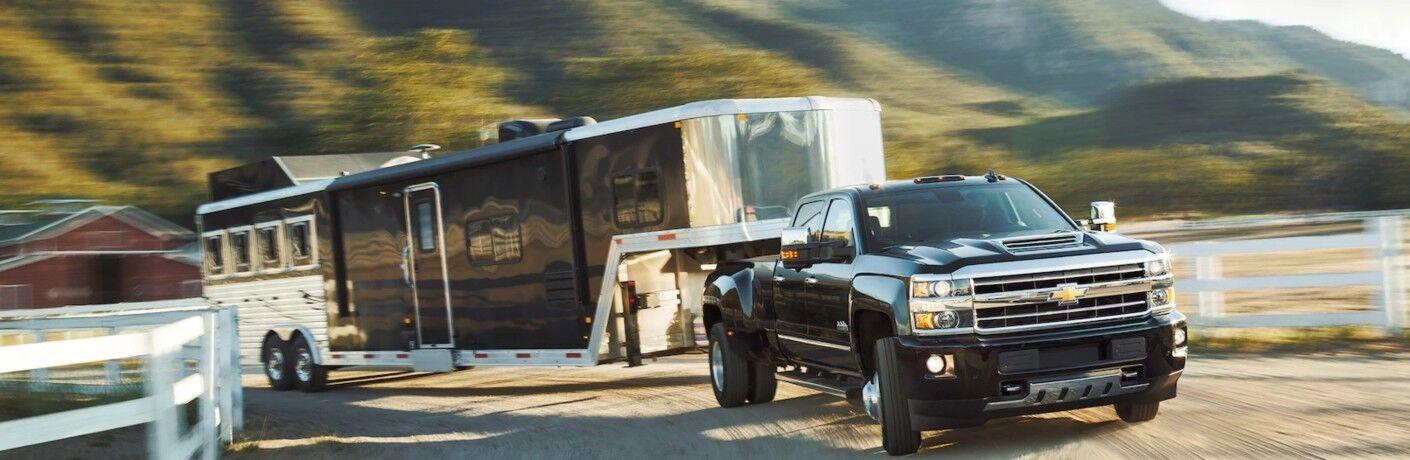 2019 Chevy Silverado 2500HD black towing a trailer