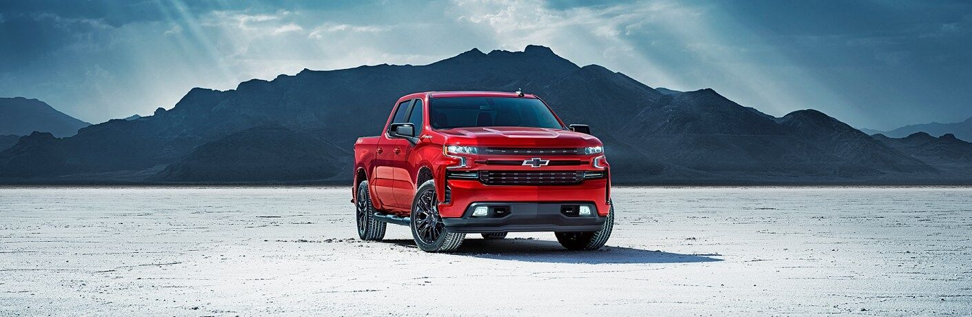 2019 Chevy Silverado red front view in front of a mountain