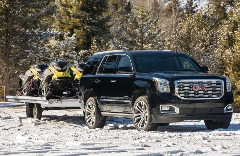 2019 GMC Yukon black towing snowmobiles