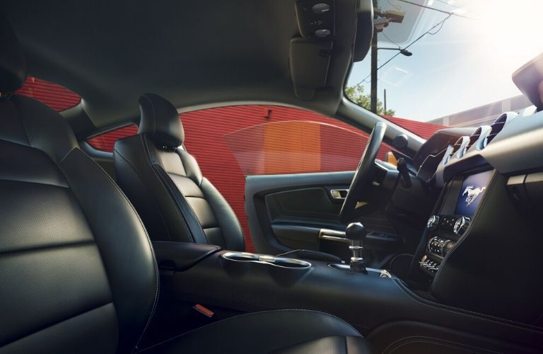 Interior view of the front seating area inside a 2020 Ford Mustang