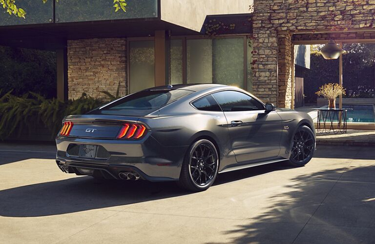 Exterior view of the rear of a gray 2020 Ford Mustang