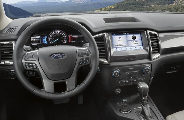 Interior view of the steering wheel and touchscreen inside a 2020 Ford Ranger