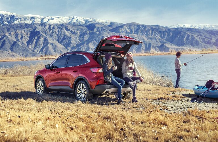 Rear view of red 2020 Ford Escape with mountains in the background