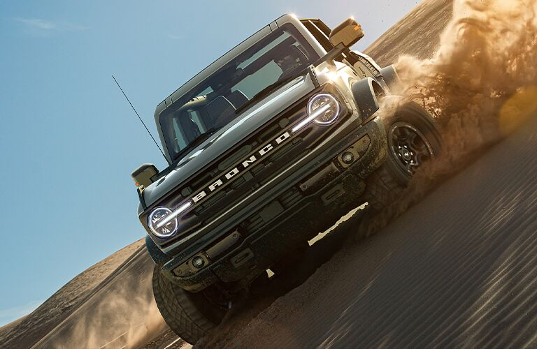 2021 Ford Bronco front view sliding in sand