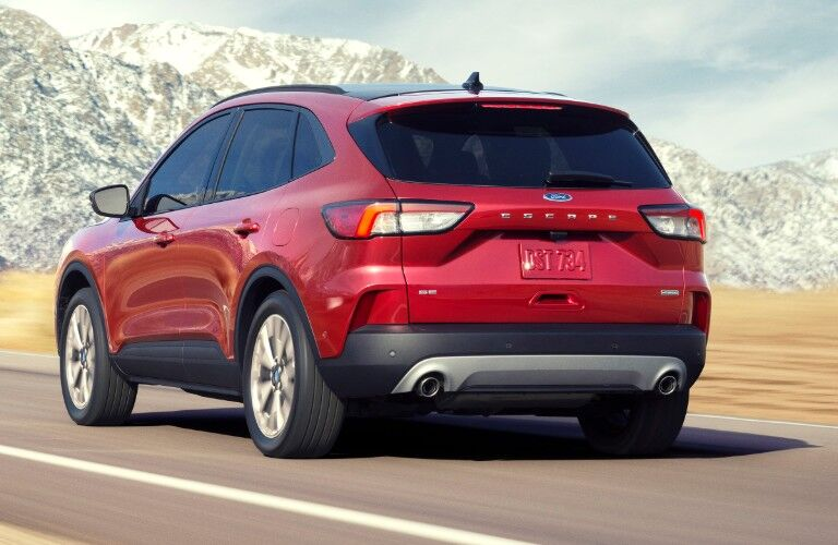 2021 Ford Escape driving down a highway road