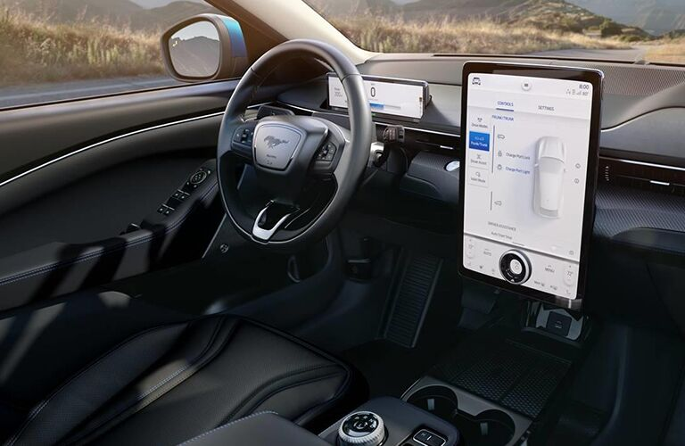 2021 Ford Mustang Mach-E all-electric SUV interior shot of driver's seat, steering wheel, and infotainment interface