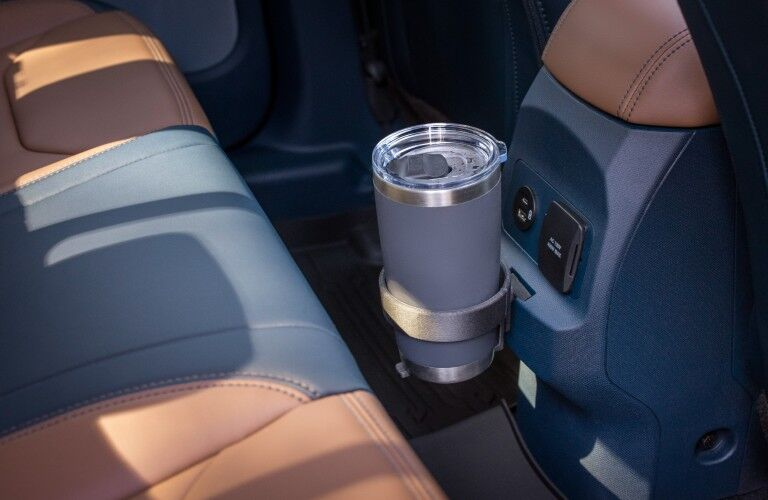 A cup holder available in the backseat of the 2022 Ford Maverick.